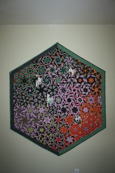 "This is a ""One Block Wonder"" made by one of the extremely talented member of QCA.  Look at it closely... it's so amazing."