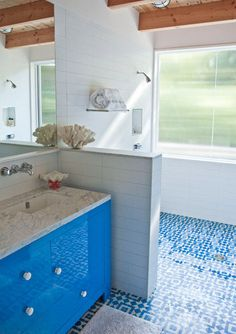 Blue tile floor, white subway tile wall. From apartment therapy - http://www.apartmenttherapy.com/a-surf-shack-with-a-midcentury-soul-172029#