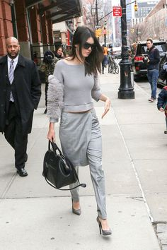 Who: Kendall Jenner What: A Pant/Skirt Hybrid Why: The model embraces an inspired monochrome look, pairing a fur-sleeve knit with trousers with a skirt overlay for a thoroughly modern fashion moment.  Get the look now: Rick Owens DRKSHDW skirt trousers, $533, farfetch.com.