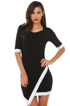 For that classy look with timeless sophistication, look no further. The AKIRA Asymmetrical Contrast Dress in Black. Featuring white trim detail at the sleeves and hem, a front wide scoop neck, and textured knit fabric. Skirt features a pointed hem. This piece plays with structure and lines to create a polished look. Unlined.
