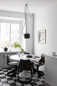 Scandinavian-style breakfast nook in black and white