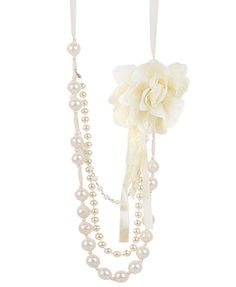 layered pearl necklace with fabric flower