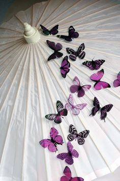 20 pack of Plum Butterflies great for decorations, Cake Toppers, table decor or childrens rooms. $18.00, via Etsy.