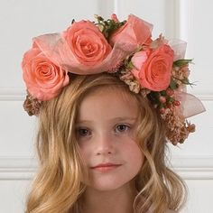 Large peach roses, hypericum berries and sheer ribbon makes up this wreath.