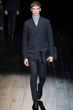 Gucci's stripe pattern is narrow and even in size. Also, they use tone down colour for not only clothes but accessories and with the turtleneck make classic atmosphere. However, bridge coat design such as 6 buttons are looking not only classic but also youthful.     Gucci | Fall 2014 Menswear Collection | Style.com