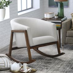 With its unique tub-shaped seat and classic rocking-chair appeal, this chair will make a strong style statement in any setting.
