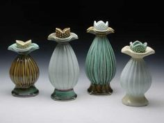 Candlestick holders, 6 in. (15 cm) in height, porcelain, fired to cone 10 in reduction, 2010.