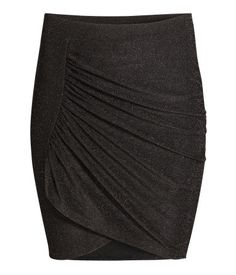 Short skirt in shimmery jersey with a wrap-style, draped front section and an elasticized waistband. Unlined.