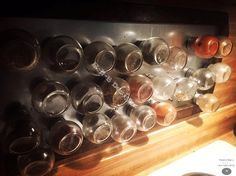 Magnetic spice rack, with hand made wooden frame.