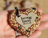 50 petite bird seed hearts with personalized tag, birdseed wedding favor, love birds. $50.00, via Etsy.