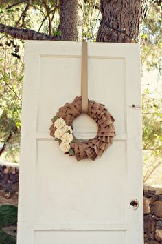 Vintage wedding decor with burlap wreath. Thanks! @Shelly Figueroa Figueroa Figueroa Figueroa Luft