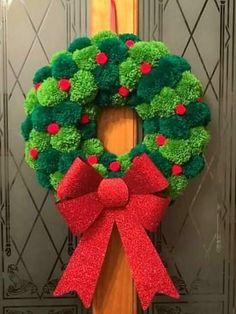 Christmas handmade holly berry pom pom wreath with large red glitter bow - Beautiful handmade Pom pom wreath. Each Pom Pom is individually hand made in 2 shades of green. Christmas Pom Pom Crafts, Crochet Christmas Decorations, Noel Christmas, Handmade Christmas, Holiday Crafts, Christmas Wreaths, Christmas Glitter, Xmas, Spring Crafts