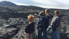 CRATERS OF THE MOON - students on lava rock