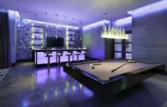 Modern basement game room with mood lighting and pool table