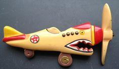 Patriotic pin:  WW II U. S. Army Air Corps 'Flying Tiger' P-40.  Bakelite Museum.