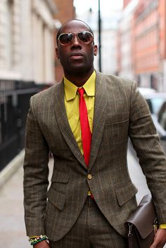 Can I get my guy to dress like this? brown plaid suit, yellow Oxford shirt, red tie.