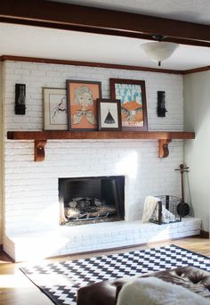 white-painted brick fireplace with wood mantle., white-painted brick fireplace with wood mantle. Wood Mantle Fireplace, Painted Brick Fireplaces, Brick Fireplace Makeover, White Fireplace, Fireplace Ideas, Mantle Art, Brick Wallpaper Fireplace, Painting A Fireplace, Wooden Mantle