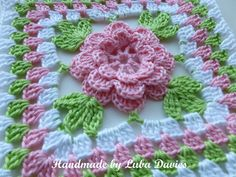 "Flower in granny square by Crochet- atelier--This is so pretty. The website rates the skill level as ""Easy"". So, maybe I can do it!? ;-)"