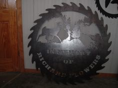 Metal art replica saw blade Memorial sign, 48 inch diameter.  I made this for a friend of mine, his best friend past on and he wanted a memorial to display at their hunting lodge. www.custommetaldesigns.webs.com