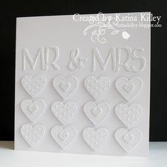 handmade wedding card ... all white ... no stamping ... MR & MRS die cut ... 12 small decorated hearts ... a bit of glitter ... stunning!!