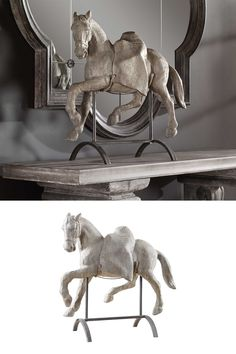 Antique reproduction horse is cast from the original carving and features an aged stone gray finish. The horse rests on a steel base, with form-fitting supports hand-wrapped in fine rope.