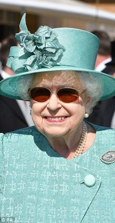 Her Majesty is pictured at a garden party today at Buckingham Palace
