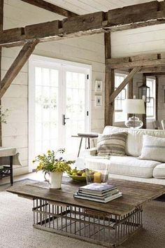 "An example of the comfortable ""lived in"" look we like; not too formal.  What we don't like: too much white, esp the couch which is not realistic; no paneling on walls; cool coffee table made from a chicken coop"