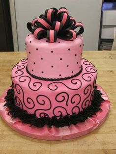 In a wedding cake section of Texas Star Bakery's cakes, but I definitely think it would be a much cuter birthday cake! Love the pink and black!