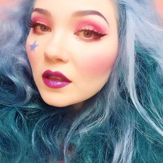 Miss @Doe Deere  rocking the Jem & The Holograms inspired look (kick-ass 80s cartoon, look it up!). On her lips: Poisonberry lipstick topped with Libra glitter.  #jem #trulyoutrageous