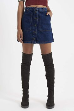 Pair our patch pocket A-line skirt with over the knee boots for casual 60s style. #Topshop
