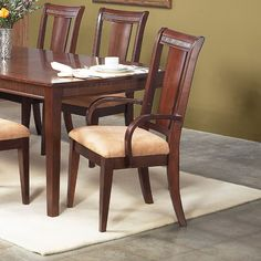 These Salvatore collection arm chairs will add just the right touch to your kitchen or dining decor. A transitional design and styling will add charm and portray a high comfort level in your home.