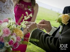 Small summer wedding in nature, the bride and the groom, her wedding flower and flower for him