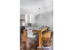 A hardy, rustic, custom pine table with bench seating fills the dining area. The chandelier matches the pendants hanging over the kitchen island. See more at http://www.ourhomes.ca/articles/build/article/rusticmodern-clutterfree-and-familyfriendly