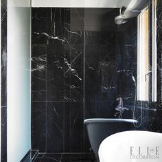 Black is a stylish alternative to white in a bathroom, and looks especially dramatic in a material such as marble, which clads the floor and walls in this smart space<span>Photography: Fabrizio Cicconi/Living Inside Styling: Francesca Davoli</span>