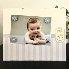 """Vintage Boy Stripes Baby Blue buttons newborn nursery theme shower gift handmade magnetic picture frame holds 5"""" x 7"""" photo 9"""" x 11"""" size. My frames are magnetic backed, covered with beautiful paper, and come with 3 embellished magnets. All frames are 9 x 11 and have a velvet easel back for free standing display or can be hung by a beautiful attached ribbon. Each frame is great for 1 to 3 pictures, notes, or recipes. You can put your pictures, notes or recipes where ever you want and then..."""