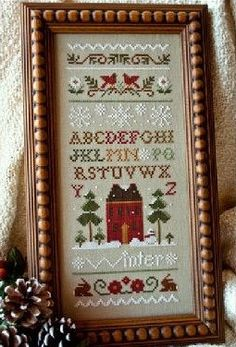 Cross stitch pattern charm pack : Winter Band Sampler Little House Needleworks Christmas counted cross stitch. $11.80, via Etsy.
