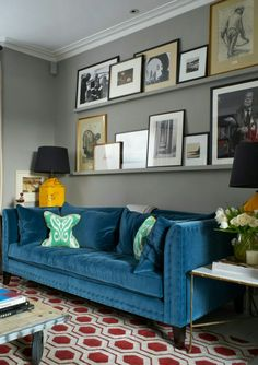 What a great way to display photos, artwork, etc. And above such a gorgeous sofa~ Houzz.com