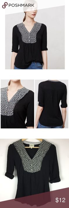 """Anthropologie Deletta Interlude Black Henley Anthropologie Interlude Henley by Deletta  As the weather gets warmer and the afternoons more adventurous, we're craving whimsical, retro-inspired pick-me-ups. With its easy slub-cotton body and patterned placket, Deletta's pullover fits the bill to a T.  Size: XS Good used condition; has some piling throughout (please see photos); priced accordingly Black Motif By Deletta Cotton Machine wash 26""""L Imported Style No. 27855741 Anthropologie Tops…"""