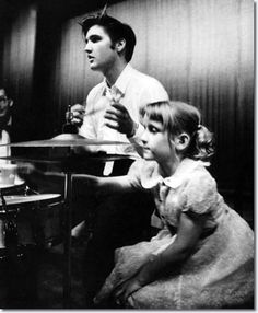 Elvis Presley with a young fan, June 30, 1956.