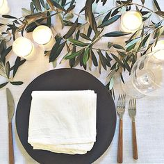 Olive branches, tea lights and flour sack linens...just a simple lil something for tonight's Friendsgiving.