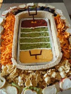 Football platter. Looks like it would take a long time to make, but I think everyone at the tailgate would be so surprised that they would snap photos and most likely Instagram them. #impressive