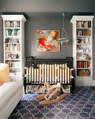 Love the paint color of this wall    Gorgeous boys nursery design with gray walls paint color, Madeline Weinrib Indigo Brooke Rug, Dream On Me Jenny Lind Classic Crib - Black, Blabla Multi-Birds Mobile, white bookcases and abstract painting art.