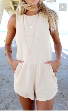 Love this cream colored romper with layered necklaces. Adorable!