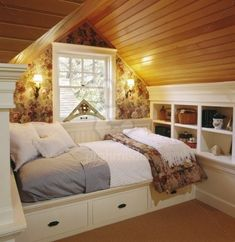 Coziest attic bedroom. Great use of space with the built-in bed/storage