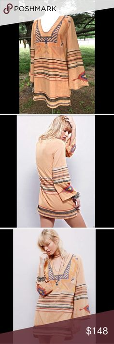 Free People terracotta peach embroidered  Dress Free People terracotta peach embroidered bell sleeve Mini Dress Inspired shift mini dress featuring allover embroidery detailing with striped accents.  Low, squared neckline and statement bell sleeves. Lined. New Without Tags  *  Size:  Small retail price:  $168.00   55% Viscose. 45% Cotton  Lining: 100% Viscose  Measurements for Small:  Bust: 40 in = 101 1/2 cm  Waist: 35 1/2 in = 90 1/4 cm  Length: 33 1/2 in = 85 cm  Sleeve Length: 23 1/2 in…