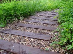 Yard landscaping ideas will look more interesting when you mix materials for creating beautiful garden paths, walkways, patios and flower beds Wood Walkway, Wooden Path, Small Yard Landscaping, Landscaping With Rocks, Landscaping Ideas, Garden Cottage, Garden In The Woods, Garden Seating, Back Gardens
