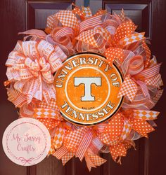 University of Tennessee Volunteers Orange and White Deco Mesh Wreath with Large Tennessee Vols Bow Diamond Plaid Polka Dot and Stripe Ribbon by MsSassyCrafts on Etsy https://www.etsy.com/listing/227472126/university-of-tennessee-volunteers