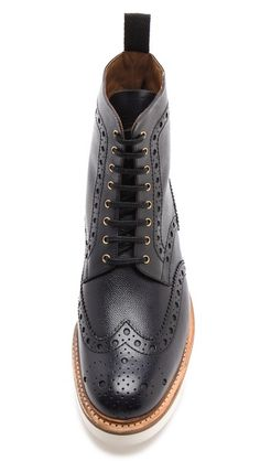 Grenson wingtip boots with an impressive wedge sole.