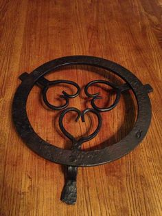 Hand forged trivet by my dad Ricky Vardell , follow him on Pinterest !