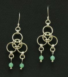 Light and airy chainmaille earrings in the Aura weave. They are accented with chrysoprase beads.